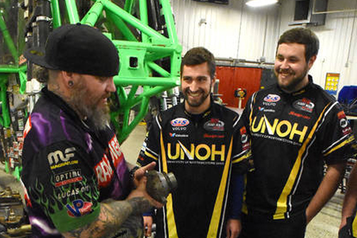 Michael Osborne, left, Grave Digger crew chief, talks shop with UNOH students, John Hartman and Brenden Rassel, during a pit stop at UNOH